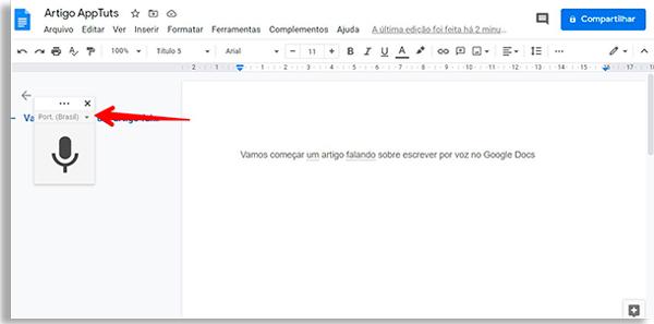 tela do google docs com botão de microfone e seta vermelha apontando para o menu de idioma localizado logo acima do botão
